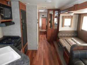 33 Foot Innsbruck RV Travel Trailer for Rent with Outdoor Kitchen and Slide-Out